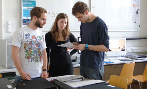 Students discussing conceptual work in progress